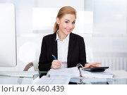 Купить «Young Businesswoman Working At Desk», фото № 6460439, снято 11 января 2014 г. (c) Андрей Попов / Фотобанк Лори