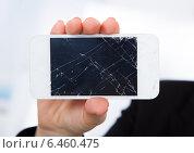 Купить «Person Holding Damaged Cellphone», фото № 6460475, снято 11 января 2014 г. (c) Андрей Попов / Фотобанк Лори