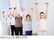 Купить «People Lifting Dumbbells At Gym», фото № 6461015, снято 15 марта 2014 г. (c) Андрей Попов / Фотобанк Лори