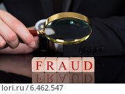Купить «Businessman Examining Fraud Blocks Through Magnifying Glass», фото № 6462547, снято 28 июня 2014 г. (c) Андрей Попов / Фотобанк Лори