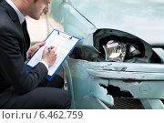 Купить «Insurance Agent Examining Car After Accident», фото № 6462759, снято 28 июня 2014 г. (c) Андрей Попов / Фотобанк Лори