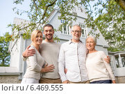 Купить «happy family in front of house outdoors», фото № 6469555, снято 21 августа 2014 г. (c) Syda Productions / Фотобанк Лори