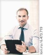Купить «businessman with tablet pc in office», фото № 6473719, снято 9 июня 2013 г. (c) Syda Productions / Фотобанк Лори