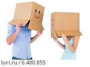Купить «Couple wearing emoticon face boxes on their heads», фото № 6480855, снято 29 апреля 2014 г. (c) Wavebreak Media / Фотобанк Лори