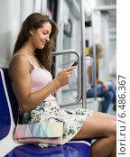 Купить «Woman using smartphone in subway», фото № 6486367, снято 5 августа 2014 г. (c) Яков Филимонов / Фотобанк Лори