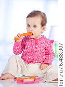 Купить «Little girl having a meal.», фото № 6488907, снято 22 мая 2019 г. (c) BE&W Photo / Фотобанк Лори