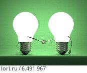 Две светящиеся лампочки, рукопожатие на зеленом фоне. Стоковая иллюстрация, иллюстратор Дмитрий Гужанин / Фотобанк Лори