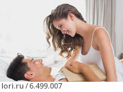Купить «Romantic couple in bed at home», фото № 6499007, снято 4 февраля 2014 г. (c) Wavebreak Media / Фотобанк Лори