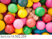 Купить «Happy boy playing in ball pool», фото № 6502259, снято 15 мая 2014 г. (c) Wavebreak Media / Фотобанк Лори