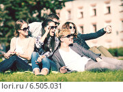 Купить «teenagers taking photo outside with smartphone», фото № 6505031, снято 15 сентября 2013 г. (c) Syda Productions / Фотобанк Лори
