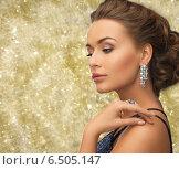 Купить «beautiful woman wearing ring and earrings», фото № 6505147, снято 17 марта 2013 г. (c) Syda Productions / Фотобанк Лори