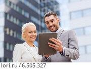 Купить «smiling businessmen with tablet pc outdoors», фото № 6505327, снято 19 августа 2014 г. (c) Syda Productions / Фотобанк Лори