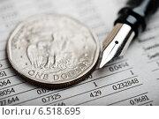 Купить «Американская монета в один доллар на финансовом отчете», фото № 6518695, снято 1 октября 2014 г. (c) Валерия Потапова / Фотобанк Лори