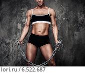 Купить «Muscular bodybuilder woman holding chains», фото № 6522687, снято 8 июня 2013 г. (c) Andrejs Pidjass / Фотобанк Лори