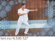 Купить «Handsome man in white doing tai chi», фото № 6530127, снято 20 августа 2018 г. (c) Wavebreak Media / Фотобанк Лори