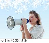Blonde businesswoman shouting through megaphone. Стоковое фото, агентство Wavebreak Media / Фотобанк Лори