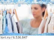 Купить «Fashion woman choosing clothes on clothes rail», фото № 6536847, снято 19 марта 2019 г. (c) Wavebreak Media / Фотобанк Лори