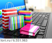 Купить «E-commerce. Online internet shopping. Laptop and shopping bags.», фото № 6551983, снято 12 апреля 2018 г. (c) Maksym Yemelyanov / Фотобанк Лори