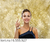 Купить «smiling woman holding glass of sparkling wine», фото № 6555927, снято 1 июня 2014 г. (c) Syda Productions / Фотобанк Лори