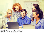 Купить «smiling team with laptop computers in office», фото № 6556867, снято 1 февраля 2014 г. (c) Syda Productions / Фотобанк Лори