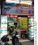 Купить «Турагентство. Сайгон. Вьетнам», фото № 6561927, снято 6 июля 2014 г. (c) Александр Подшивалов / Фотобанк Лори