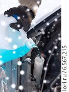 Купить «closeup of man pouring antifreeze into car», фото № 6567215, снято 16 января 2014 г. (c) Syda Productions / Фотобанк Лори