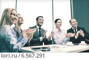 Купить «business team with laptop clapping hands», фото № 6567291, снято 9 ноября 2013 г. (c) Syda Productions / Фотобанк Лори