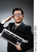 Купить «Comouter geek with computer keyboard», фото № 6567931, снято 21 мая 2014 г. (c) Elnur / Фотобанк Лори