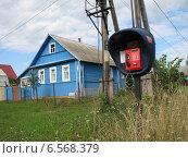 Купить «Таксофон на улице, город Зубцов, Тверская область», эксклюзивное фото № 6568379, снято 6 августа 2011 г. (c) lana1501 / Фотобанк Лори
