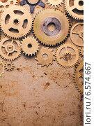 Купить «Металлические шестерни на старом металле», фото № 6574667, снято 2 октября 2014 г. (c) Оксана Ковач / Фотобанк Лори