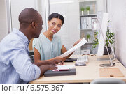 Купить «Happy business team working at desk together», фото № 6575367, снято 18 июня 2014 г. (c) Wavebreak Media / Фотобанк Лори