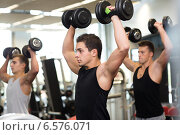 Купить «group of men with dumbbells in gym», фото № 6576071, снято 28 сентября 2014 г. (c) Syda Productions / Фотобанк Лори