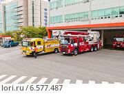 Купить «Специальная техника возле пожарной части в городе Пусан, Южная Корея», фото № 6577487, снято 26 сентября 2014 г. (c) Иван Марчук / Фотобанк Лори