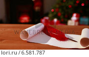 Купить «Scroll and quill on table at christmas», видеоролик № 6581787, снято 29 мая 2020 г. (c) Wavebreak Media / Фотобанк Лори