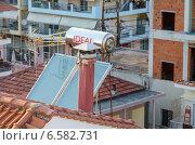 Купить «Солнечный коллектор на крыше дома, Греция», фото № 6582731, снято 7 августа 2014 г. (c) Ольга Коцюба / Фотобанк Лори