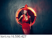 woman in red and concrete wall behind. Стоковое фото, фотограф Александр Буц / Фотобанк Лори