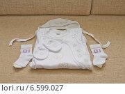 Одежда для новорожденного. Стоковое фото, фотограф Анастасия Улитко / Фотобанк Лори