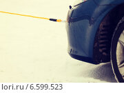 Купить «closeup of towed car with towing rope», фото № 6599523, снято 16 января 2014 г. (c) Syda Productions / Фотобанк Лори