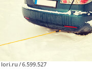 Купить «closeup of towing car with towing rope», фото № 6599527, снято 16 января 2014 г. (c) Syda Productions / Фотобанк Лори