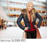 Купить «smiling young woman with shopping bags», фото № 6599951, снято 13 ноября 2010 г. (c) Syda Productions / Фотобанк Лори