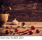 Купить «Mortar and pestle with pepper and spices on wooden table», фото № 6607251, снято 5 апреля 2014 г. (c) Майя Крученкова / Фотобанк Лори