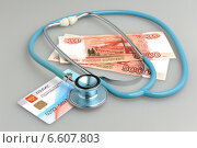 Купить «Стетоскоп, деньги и полис медицинского страхования», фото № 6607803, снято 6 октября 2014 г. (c) Алексей Карпов / Фотобанк Лори