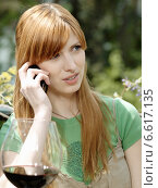 Купить «A girl talking through a mobile.», фото № 6617135, снято 14 декабря 2019 г. (c) BE&W Photo / Фотобанк Лори