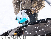 Купить «closeup of man pouring antifreeze into car», фото № 6617183, снято 16 января 2014 г. (c) Syda Productions / Фотобанк Лори