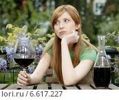 Купить «A girl with a glass an carafe with red wine.», фото № 6617227, снято 7 декабря 2019 г. (c) BE&W Photo / Фотобанк Лори