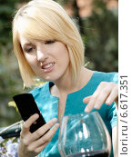 Купить «A girl looking at mobile phone.», фото № 6617351, снято 14 декабря 2019 г. (c) BE&W Photo / Фотобанк Лори