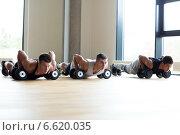 Купить «group of men with dumbbells in gym», фото № 6620035, снято 28 сентября 2014 г. (c) Syda Productions / Фотобанк Лори