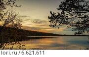 Купить «Закат над осенним озером, таймплапс», видеоролик № 6621611, снято 9 октября 2014 г. (c) Слуцкий Александр Сергеевич / Фотобанк Лори