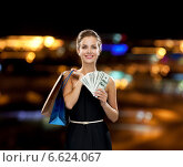 Купить «smiling woman in dress with shopping bags», фото № 6624067, снято 1 июня 2014 г. (c) Syda Productions / Фотобанк Лори