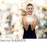 Купить «laughing woman in evening dress holding something», фото № 6624075, снято 1 июня 2014 г. (c) Syda Productions / Фотобанк Лори